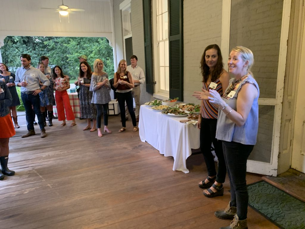 Bonnie (right) and Caroline (left) welcoming the Moonlighter Committee to the 2019 Once in a Blue Moon Kickoff Event at Glen Leven Farm.