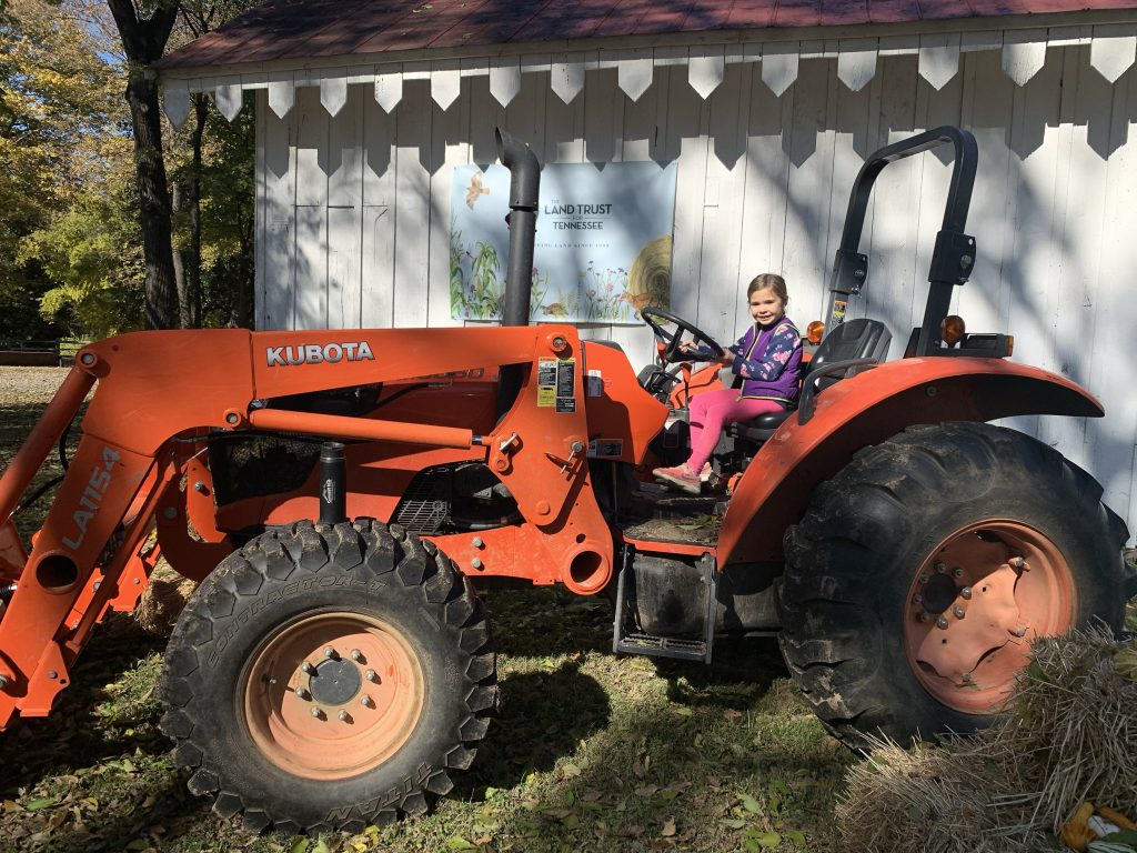 Girl on tractor, Family Farm Day
